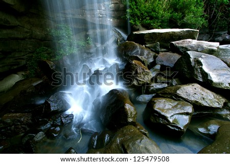 Waterfall in the forest - stock photo