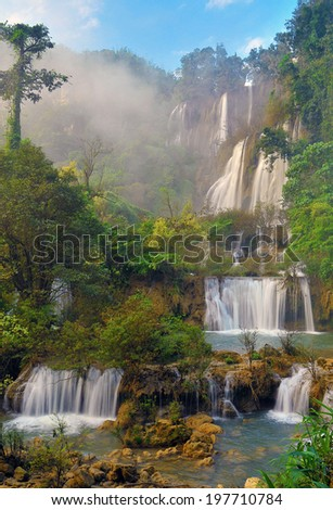 Waterfall in the forest. - stock photo