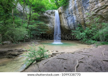 Waterfall in the forest canyon in Crimea