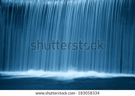 waterfall in the forest in the night - stock photo
