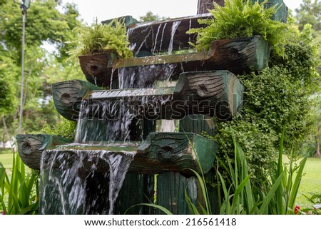 Waterfall in the garden - stock photo