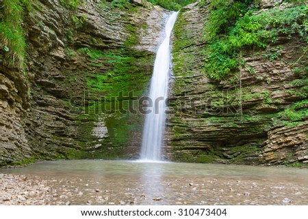 Waterfall in the mountains of the North Caucasus.