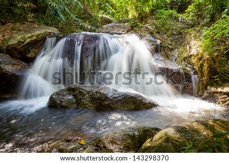 Waterfall in the park forest in the Thailand.