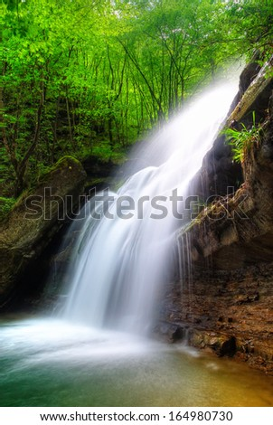 waterfall in the tropical forest - stock photo