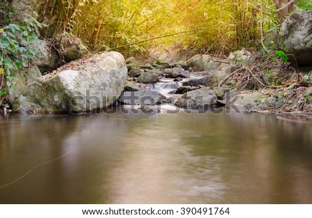 Waterfall in the tropical forest with sunlight, Thailand - stock photo