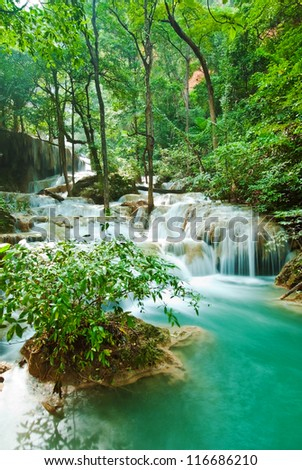 waterfall in tropical forest at Erawan national park Kanchanaburi province Thailand - stock photo