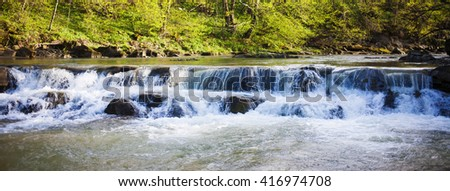 Waterfall in Western Ukraine in the Carpathian mountains. - stock photo