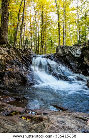 Waterfall inside forest - stock photo