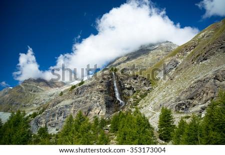 Waterfall is the swiss Alps, Zermatt - stock photo
