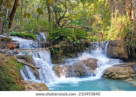 Waterfall Kuang Si in the jungle near Luang Prabang, Laos - stock photo