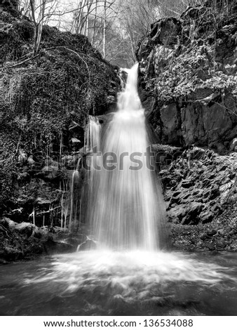 waterfall landscape black and white - stock photo