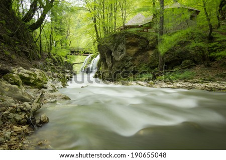 Waterfall landscape in Romania with beautiful green and waterfall named Bigar