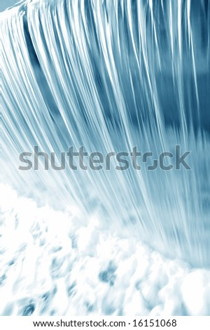 waterfall long exposure blue tones - stock photo
