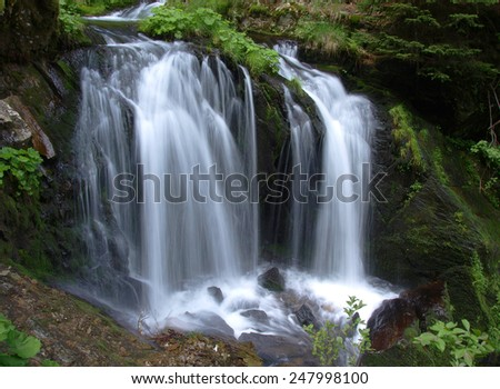 Waterfall long exposure landscape image in in the Protected area Jeseniky mountains Czech republic - stock photo