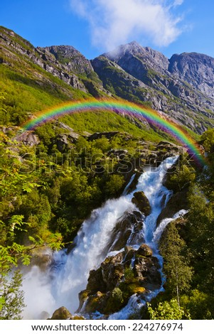 Waterfall near Briksdal glacier - Norway - nature and travel background - stock photo