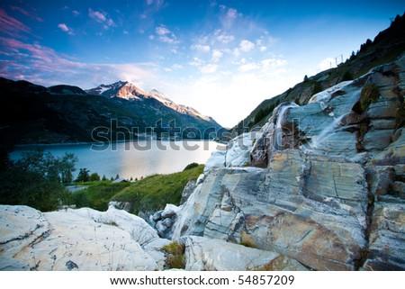 Waterfall near Lake at Tignes, France - stock photo