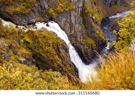 Waterfall, Norway - Eidfjord Voringfossen - Beautiful waterfall in autumn forest - stock photo