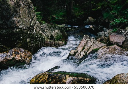 Waterfall of a stream in a valley