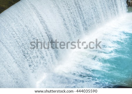 Waterfall on a big dam. Cascade on Segre river in Spain - stock photo
