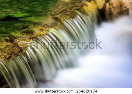Waterfall on small mountains brook - stock photo
