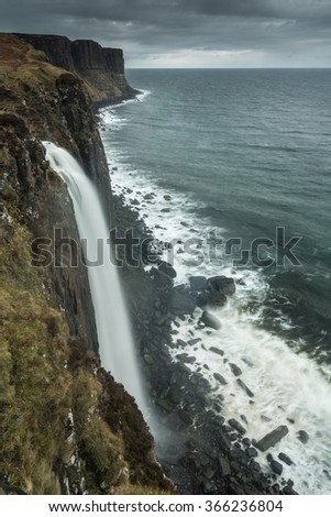 Waterfall on the cliff at coastline, Scotland - stock photo