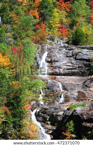 waterfall on the rock in autumn mountain