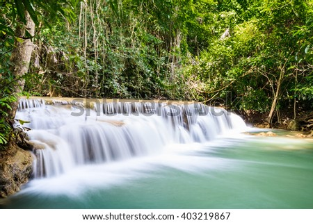 waterfall steps  and green water in Thailand National Park.