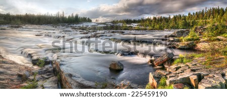 Waterfall Trappstegsforsen in the morning - North Sweden near Vilhelmina - stock photo