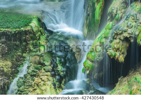 waterfall waters, algae and greening - stock photo