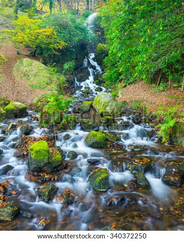 Waterfall which flows in to Burrator Reservoir on Dartmoor National Park England UK Europe