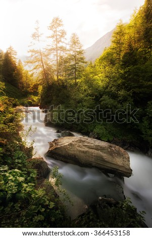 Waterfall with beautiful light in the mountains