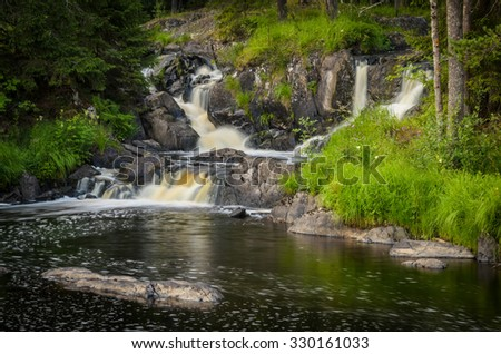 waterfall with cascades in the forest