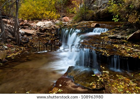 Waterfall with fall color from Zion National park - stock photo
