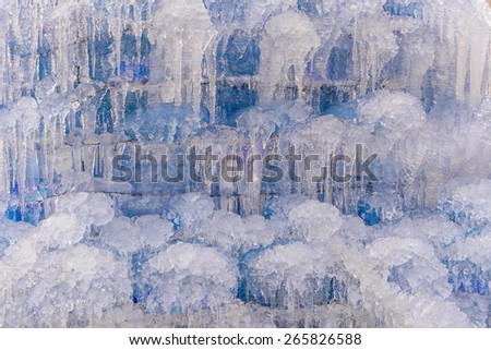 waterfall with ice in a blue and white color in winter. - stock photo