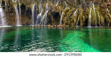 Waterfall with large rocks and splashing water - stock photo