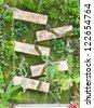 Waterfall with wooden box, gardening design. - stock photo