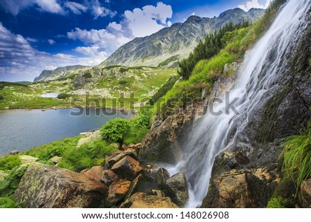 Waterfalls and lake in the mountains
