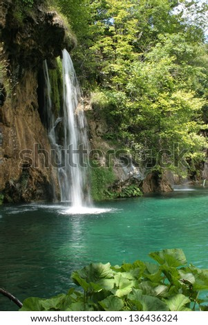 Waterfalls and lakes in plitvice parc in Croatia. Clear blue water in a green and colorful nature - stock photo