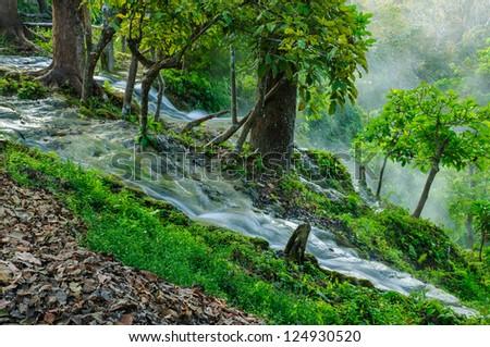 Waterfalls and the misty morning at Bua Tong National Park, Chiang Mai Thailand - stock photo