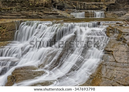 Waterfalls cascading over the rocks at the Robert H. Treman State Park in New York