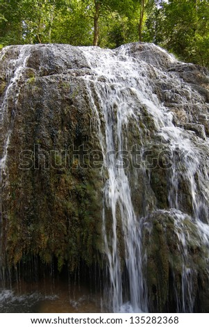 waterfalls descend between the rocks and boil it - stock photo