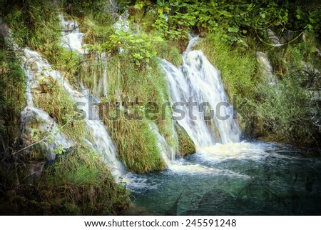 Waterfalls in Plitvice, Croatia on grungy background