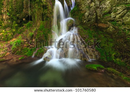 Waterfalls in the mountains in Transylvania on a  spring day - stock photo