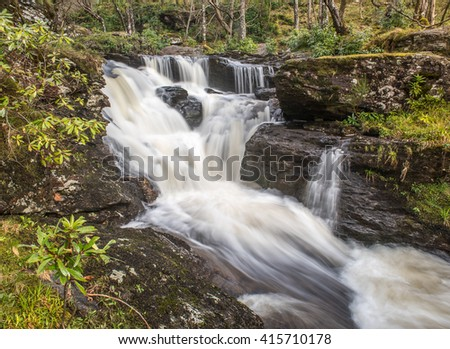Waterfalls in Woods at Inversnaid - stock photo