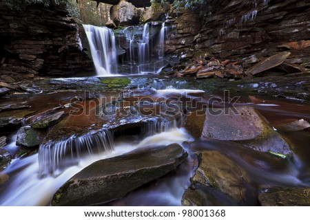 Waterfalls, tannin colored stream and rocks in the Appalachians