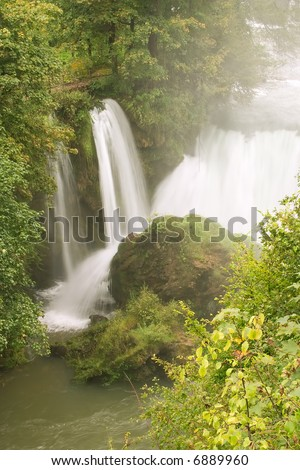 Waterfalls with lake in forest