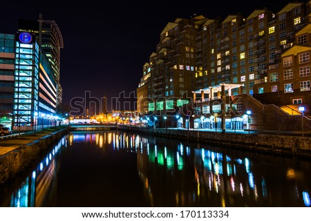 Waterfront buildings at night in the Inner Harbor, Baltimore, Maryland. - stock photo