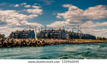 Waterfront condos and a jetty in Point Pleasant Beach, New Jersey. - stock photo