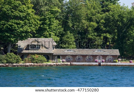 Waterfront home with a large boathouse