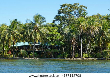 Waterfront house with tropical garden on the island of Carenero, Bocas del Toro, Caribbean sea, Panama - stock photo